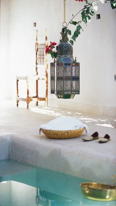 I would love Moroccan tin lanterns hung low over the edge of a magical aqua pool... so relaxing and chic ...Bohemian or Morrocan