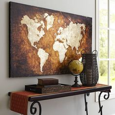 World Map Art - Bronze (this is exactly what I want my place to look like. These colors. The bronze, the iron spiralwork on the desk, the globe, the books........every single thing in this photo, I want in my home.