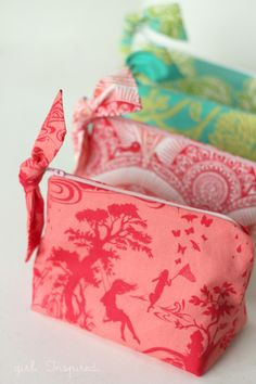 """You know how you see a project flash across your computer screen and you just can't stop thinking about it? When I saw Kate's """"Little Zippered Bow Pouch"""" tutorial, I knew I needed to make a few for the girls. These little bags sew up in no time and they are adorable. They're really quite...Read More »"""