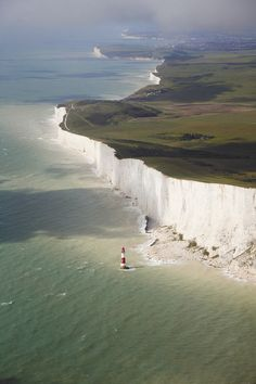 Beachy Head, England White cliffs and a little candy striped lighthouse.