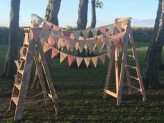 Two ladders for my sister's wedding arch. They were uneven and my mother made the bunting. Brought the ladders off trademe for $50. Let me know what you think.