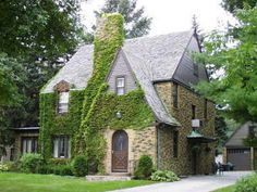 Ivy covered A-frame stone Tudor, cir. 1920-1930