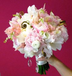 Bridal bouquet with peonies, lily of the valley, sweet pea, astilbe and ranunculus