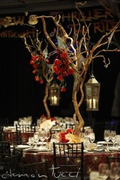Halloween Countdown: Halloween Wedding Decor Part 1   SheWalksSoftly .. I'm really liking the tree branch use for centerpieces