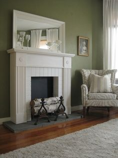 Faux Fireplace. Like this idea but I would add a stone veneer or tile to the black space