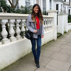 Mimi Ikonn   Grey coat, red sweater, checkered shirt, skinny jeans, black boots and bag