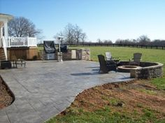 This is a stamped concrete patio, walk, fire pit and outdoor kitchen installed by OTG Custom Concrete Inc. Call today for your free outdoor escape estimate. Backyard Hammock, Backyard Patio, Backyard Landscaping, Cement Patio, Concrete Backyard, Concrete Patios, Diy Patio, Patio Ideas, Outdoor Ideas