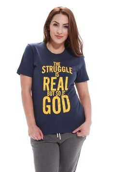 """The Struggle Is Real But So Is God has a message designed to uplift you and the people who read it. Inspired by Isaiah 41:13, """"For I am the LORD your God who takes hold of your right hand and says to you, Do not fear; I will help you"""". This design has a distressed font in a yellow/gold ink color on a Navy blue unisex men's/women's tee shirt. Model Felicia 5'6"""" wearing Small Unisex Pre-shrunk 100% cotton 6 ounce t-shirt. Double-needle stitched neckline, sleeve and b..."""