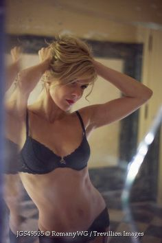 Trevillion Images - woman-in-underwear-looking-in-mirror