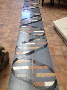 Double helix floor. Coolest floor I have ever seen made out of marble - Imgur (comments on this page are hysterical too - nerd humor is the best).