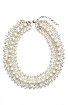 A mix of sparkling crystals and luminous glass pearls creates a striking multistrand necklace that's both polished and whimsical.