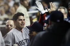 Boston Red Sox's Jacoby Ellsbury celebrates with teammates after scoring on an RBI single by Cody Ross during the first inning of a baseball game against the New York Yankees, Wednesday, Oct. 3, 2012, in New York. (AP Photo/Frank Franklin II)