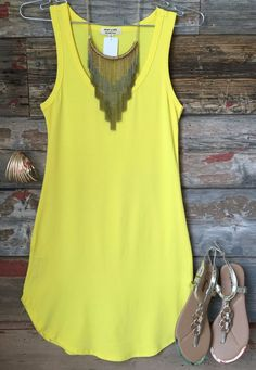 The Fun in the Sun Tank Dress in Yellow is comfy, fitted, and oh so fabulous! A great basic that can be dressed up or down! Sizing: Small: 0-3 Medium: 5-7 Large: 9-11 True to Size with a Stretchy, Fit