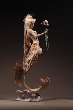 Fish from Versailles, Mermaid in Kato Polyclay by Forest Rogers. She'd stand about 9 inches as a person with legs.