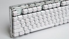 Completely clear Acrylic case with white PCB clearly visible. Vortex keycaps.