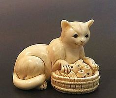 A-MUSEUM-QUALITY-ANTIQUE-NETSUKE-OF-A-CAT-AND-HIS-BASKET-OF-FISHS-SIGNED-RARE - 5cm x 3cm.