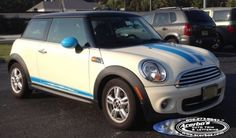 Acerbo's custom designed and cut these CYAN blue hood stripes, side rocker stripes, and rear stripes decals to match this customer's White Mini Cooper's Mirror Caps and Skuttles! www.acerbos.com