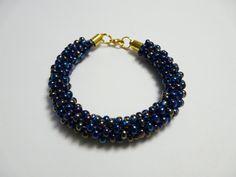 kumihimo bracelet blue /gold beads, black cord by HobbyANDme on Etsy