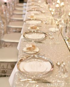 This is all about glitz and glam and the sequin linens and silver-rimmed chargers at this wedding create a sleek and dazzling placesetting. #WedLuxe