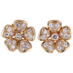 Van Cleef & Arpels Diamond Gold Flower Earrings | From a unique collection of vintage clip-on earrings at https://www.1stdibs.com/jewelry/earrings/clip-on-earrings/