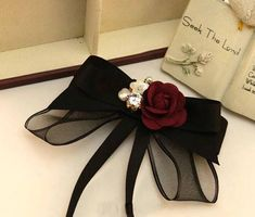 Handmade women bowtie with black ribbons and rhinestone. Great national gift for girlfriend, women, wife, mother or daughter on Christmas or any other occasion. This handmade bow tie can be worn on a shirt, a dress, a sweater, a t-shirt or as an accessory for coat, bag or everything