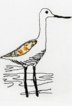 Free-machine embroidered wading bird. Close-up taken from framed picture.