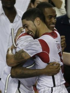 Kevin Ware gets a hug from Peyton Siva Louisville College Basketball - Cardinals Photos - ESPN