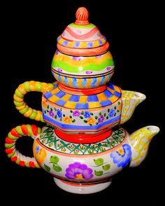 This three in one teapot is utterly unique, and also very pretty!  w.