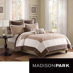 @Overstock.com - Madison Park Danville Brown/Ivory Pieced Seven-piece Coverlet Set - This neutral coverlet set is designed to coordinate easily with any bedroom. The 100 percent polyester microfiber cover is machine washable for convenience. The set includes one quilted coverlet, two pillow shams, two euro shams, and two pillows.  http://www.overstock.com/Bedding-Bath/Madison-Park-Danville-Brown-Ivory-Pieced-Seven-piece-Coverlet-Set/6737571/product.html?CID=214117 $109.99