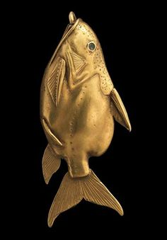 """A gold fish pendant. Egyptian Middle Kingdom c. (Photo: courtesy of National Museums Scotland). This piece will be part of the Metropolitan Museum's fall exhibit, """"Artistic Achievements of the Middle Kingdom. Art Antique, Antique Jewelry, Vintage Jewelry, Objets Antiques, Ancient Jewelry, Viking Jewelry, Egyptian Art, Ancient Artifacts, Animal Jewelry"""
