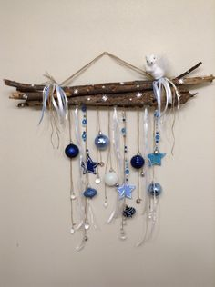 Christmas wall hanging using ribbon, twine, sticks, ornaments, copper wire, beads, jewels and crystals.