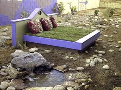 A small water feature and the grass bed are the only things that need periodic maintenance and watering in this dry alpine garden, designed by Pamela Berstler.