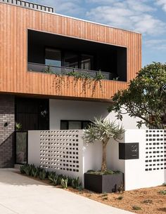 The contemporary exterior of this home reveals a 'box on box' design. The upper-level cladding is Weathertex Weathergroove. The lower level features breeze blocks. Custom Home Designs, Custom Homes, Facade Design, House Design, Box Design, Bright Homes, A Frame House, Facade House, House Facades