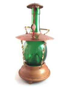 """Great retro musical green glass lantern bottle, the bottle is etched with the name 'Scheibel"""" and stands approx 9"""" tall.    The handle seems to be brass, the rim appears to... #etsysale #shopsmall #vintageshop #vintagelife #vintagelover #vintage #collectibles"""
