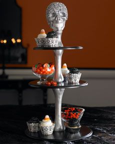 skull and bones pedestal and other really cute serving dishes. Love the witches hat too!