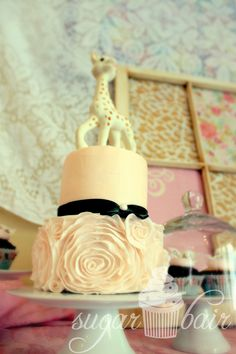 French/Parisian-inspired pink ruffle rosette Sophie la Giraffe cake {First Birthday Smash Cake}