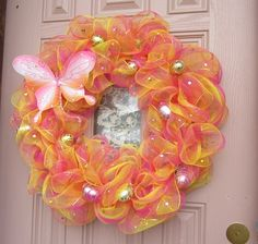 I made my Easter wreath with 2 tone deco mesh and put a butterfly and Easter eggs with gem stones on it.