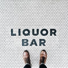 I will take my cocktail with a side of a unique tile floor design please! Floor Design, Tile Design, Pattern Design, Lettering, Typography, Liquor Bar, Penny Tile, Branding, Environmental Graphics