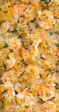 Garlicky Baked Shrimp 1 lb. raw shrimp, deveined and peeled 4 cloves garlic, minced 3 Tbsp. white wine salt and pepper 1/4 cup (4 Tbsp.) melted butter 1/2 cup Panko bread crumbs 2 Tbsp. fresh Italian-leaf parsley, chopped half of a lemon (optional)
