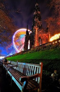 Scott Monument (in honor of Sir Walter Scott) and Ferris wheel in Edinburgh, Scotland.