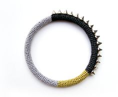 Hey, I found this really awesome Etsy listing at https://www.etsy.com/listing/197612474/metallic-spike-bangle-black-silver-gold