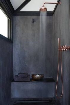 If we've learned anything from this spot it's that pink copper hardware was made to be paired with a bold charcoal paint! Matte black detailing completes the look.