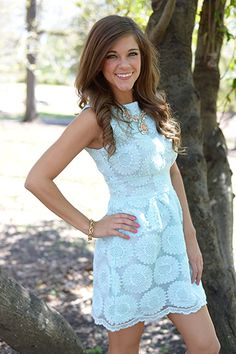"""EEK! This light blue beauty is SO CUTE! The flawless fit is made even better by the lacy sunflowers! This would make such a perfect Easter dress! Fits true to size. Miranda is wearing the small. Shoulder to hem: S - 32"""" M - 32.5"""" L - 33"""""""