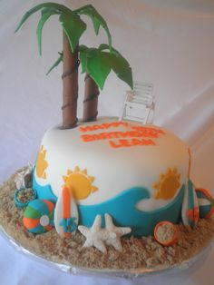 This beach-themed birthday cake features plenty of thematic elements including a beach chair, palm trees, starfish, surfboards, and much much more. Beach Themed Cakes, Themed Birthday Cakes, Theme Cakes, 50th Birthday, Cupcakes, Cupcake Cakes, Sea Cakes, Birthday Cakes For Women, Novelty Cakes