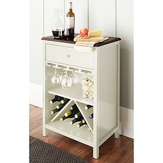 The handsomely designed and versatile Chatham House Baldwin Wine Cabinet is a great addition to any home. This stylish piece holds up to 16 bottles and has a beautiful natural wood top panel that is complemented by the cabinet's contrasting painted body.