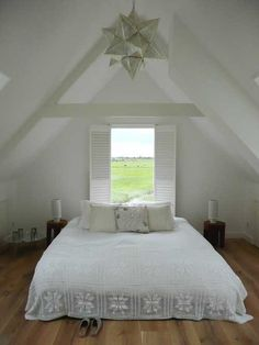 love that arched ceiling over the bed.