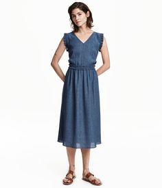 Calf-length dress in crinkled woven fabric. V-neck, ruffles around armholes, and elasticized seam at waist with ruffle. Unlined.
