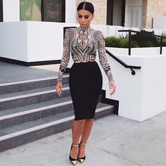@Amrezy in HMS - Top available here: http://www.hotmiamistyles.com/Aztec_Print_Mesh_Long_Sleeves_Bodysuit_p/kj57541aztec.htm
