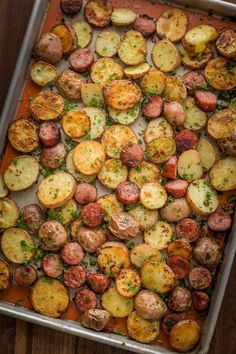 These roasted potatoes are ultra crispy and flavorful with a perfect browning on the coins of kielbasa. Easy, one-pan roasted potatoes and sausage recipe | natashaskitchen.com