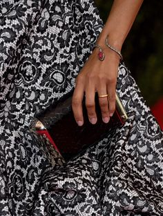 """Zoe Saldana (clutch detail) attends the """"Charles James: Beyond Fashion"""" Costume Institute Gala at the Metropolitan Museum of Art on May 5, 2014 in New York City."""
